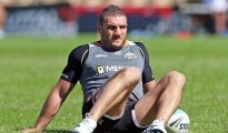SYDNEY, AUSTRALIA - APRIL 08:  Robbie Farah stretches during a Wests Tigers NRL training session at Leichhardt Oval on April 8, 2015 in Sydney, Australia.  (Photo by Renee McKay/Getty Images)
