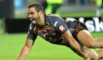 GOLD COAST, AUSTRALIA - FEBRUARY 13: Greg Inglis of the Indigenous All Stars celebrates after scoring a try  during the NRL pre-season match between the Indigenous All Stars and the NRL All Stars at Cbus Super Stadium on February 13, 2015 in Gold Coast, Australia.  (Photo by Bradley Kanaris/Getty Images)