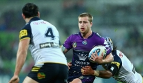 MELBOURNE, AUSTRALIA - AUGUST 29:  Cameron Munster of the Storm is tackled during the round 25 NRL match between the Melbourne Storm and the North Queensland Cowboys at AAMI Park on August 29, 2015 in Melbourne, Australia.  (Photo by Robert Prezioso/Getty Images)