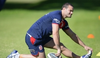 SYDNEY, AUSTRALIA - MAY 08:  Boyd Cordner of the Roosters stretches during a Sydney Roosters NRL training session at Kippax Lake on May 8, 2014 in Sydney, Australia.  (Photo by Brett Hemmings/Getty Images)